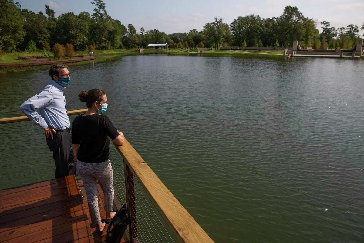 The Kinder Foundation's Guy Hagstette and Sarah Newbery walk the grounds at Hines Lake at Memorial Park.