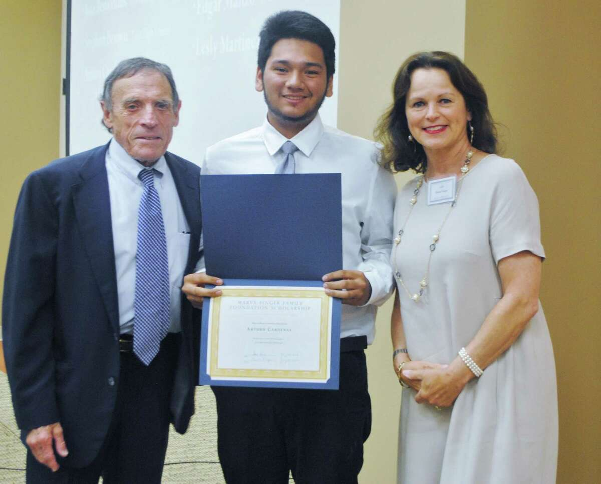 Arturo Cardenas received a Level 2 certificate of technology in automotive technology from San Jacinto Community College. Cardenas, center, is shown with Marvy and Elaine Finger at a banquet to celebrate the 2016 class of students who received scholarships for technical education through the Marvy Finger Family Foundation Scholarship program.