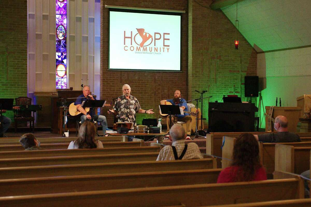 The Rev. Jack Womack speaks to his congregation at Hope Community Methodist Church in Pasadena, which began holding in-person services again in September after having been strictly online since last May. The church has phased its way into a new way of worshiping, including music without congregational singing.