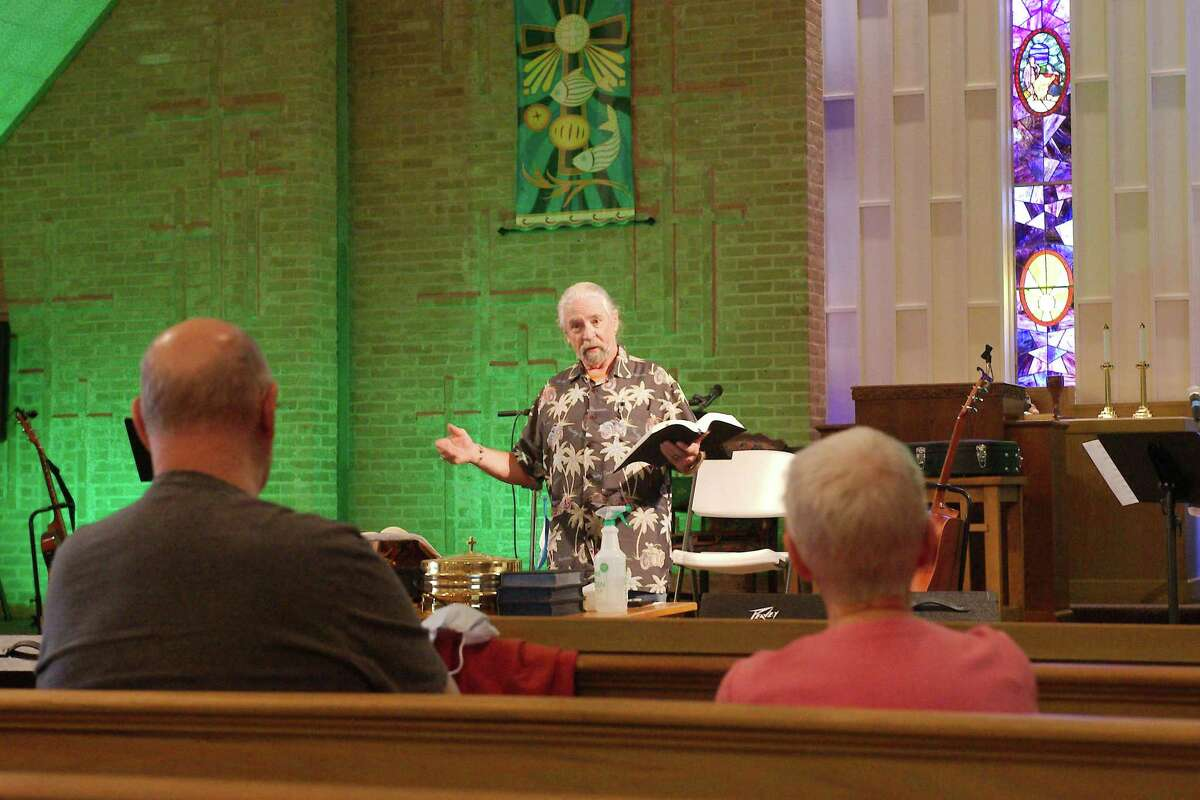 Joe and Eileen Unger listen as the Rev. Jack Womack during the service at Hope Community Methodist Church.
