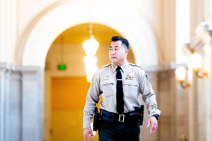 San Francisco Sheriff Paul Miyamoto walks through San Francisco City Hall on Friday, Aug. 7, 2020.