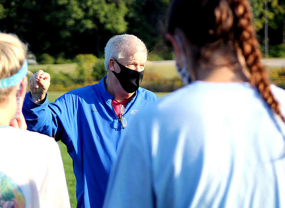 Lewis and Clark Community College women's soccer coach Tim Rooney, wearing a protective face mask, speaks with his players during an early morning practice Thursday at LCCC. It was the team's first off-season practice of the year, since the NJCAA moved the season from fall to spring because of the COVID-19 pandemic. Photo: Pete Hayes | The Telegraph