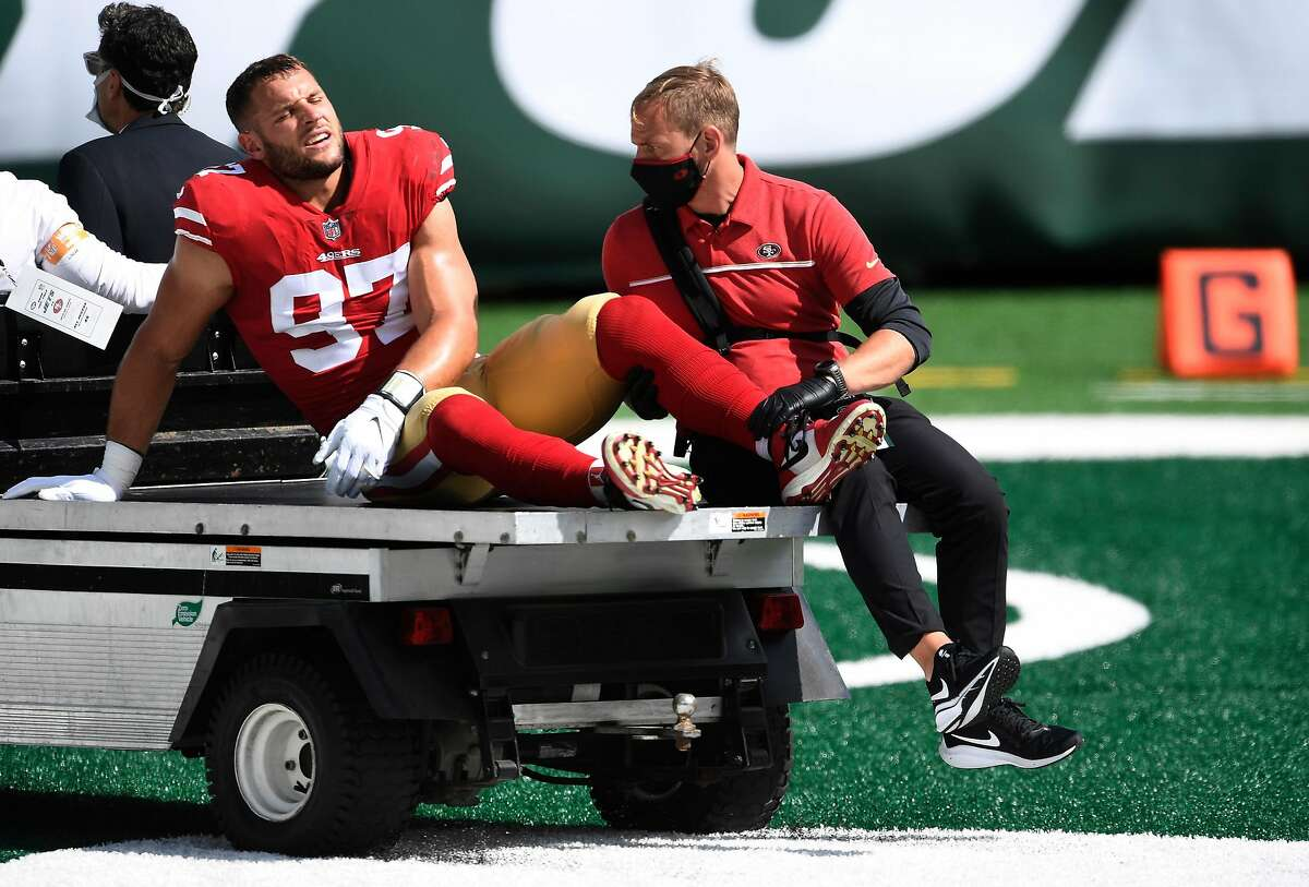 In this file photo, Nick Bosa (97) of the San Francisco 49ers is carted off the field after sustaining an injury during the first half against the New York Jets at MetLife Stadium on September 20, 2020 in East Rutherford, NJ. The NFL and NFL Players'Association were conducting an additional test of MetLife Stadium's FieldTurf surface on Wednesday ahead of Sunday's Giants-49ers game. (Sarah Stier/Getty Images/TNS)