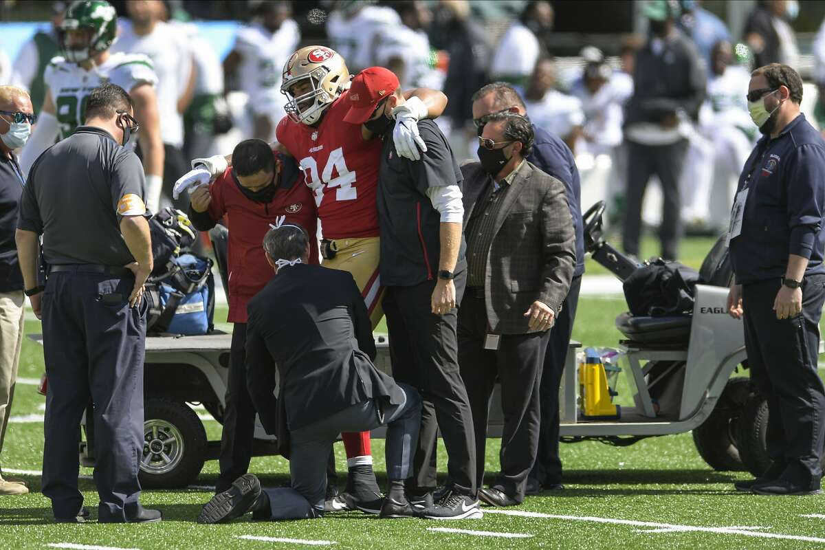 San Francisco 49ers defensive end Solomon Thomas (94) is helped off the field after being hurt during the first half of an NFL football game against the New York Jets Sunday, Sept. 20, 2020, in East Rutherford, N.J. (AP Photo/Bill Kostroun)