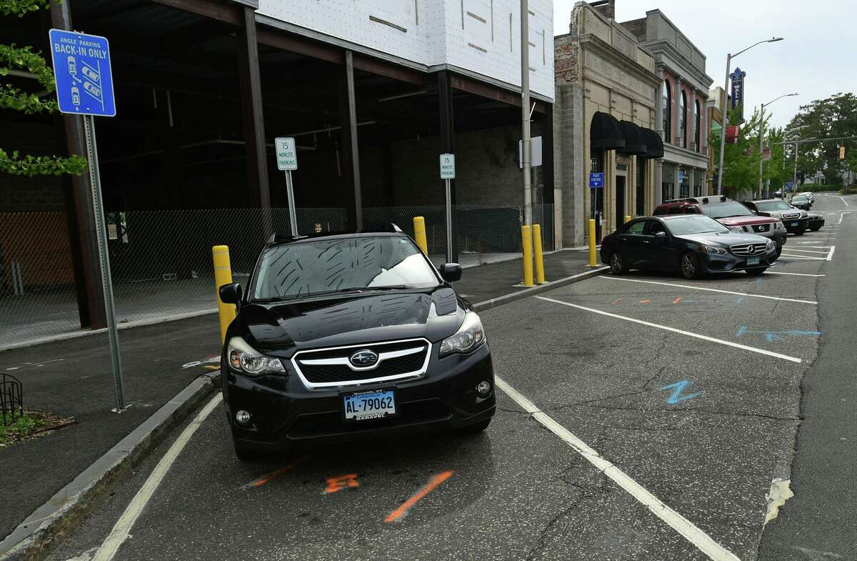 """The new back-in, angled parking on Wall St Thursday, September 22, 2020, which were unveiled last year in Norwalk, Conn. The Parking authority did a """"check in"""" at their latest meeting and concluded the spaces a success, but are looking to replace the yellow bollards with something more aestethic."""