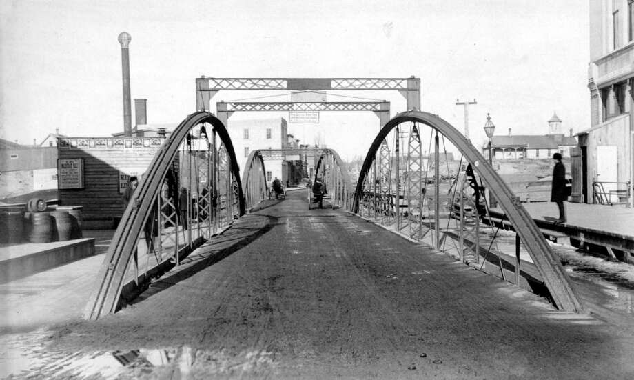 This photo shows a view of the Maple Street Bridge in 1888. (Manistee County Historical Museum photo)