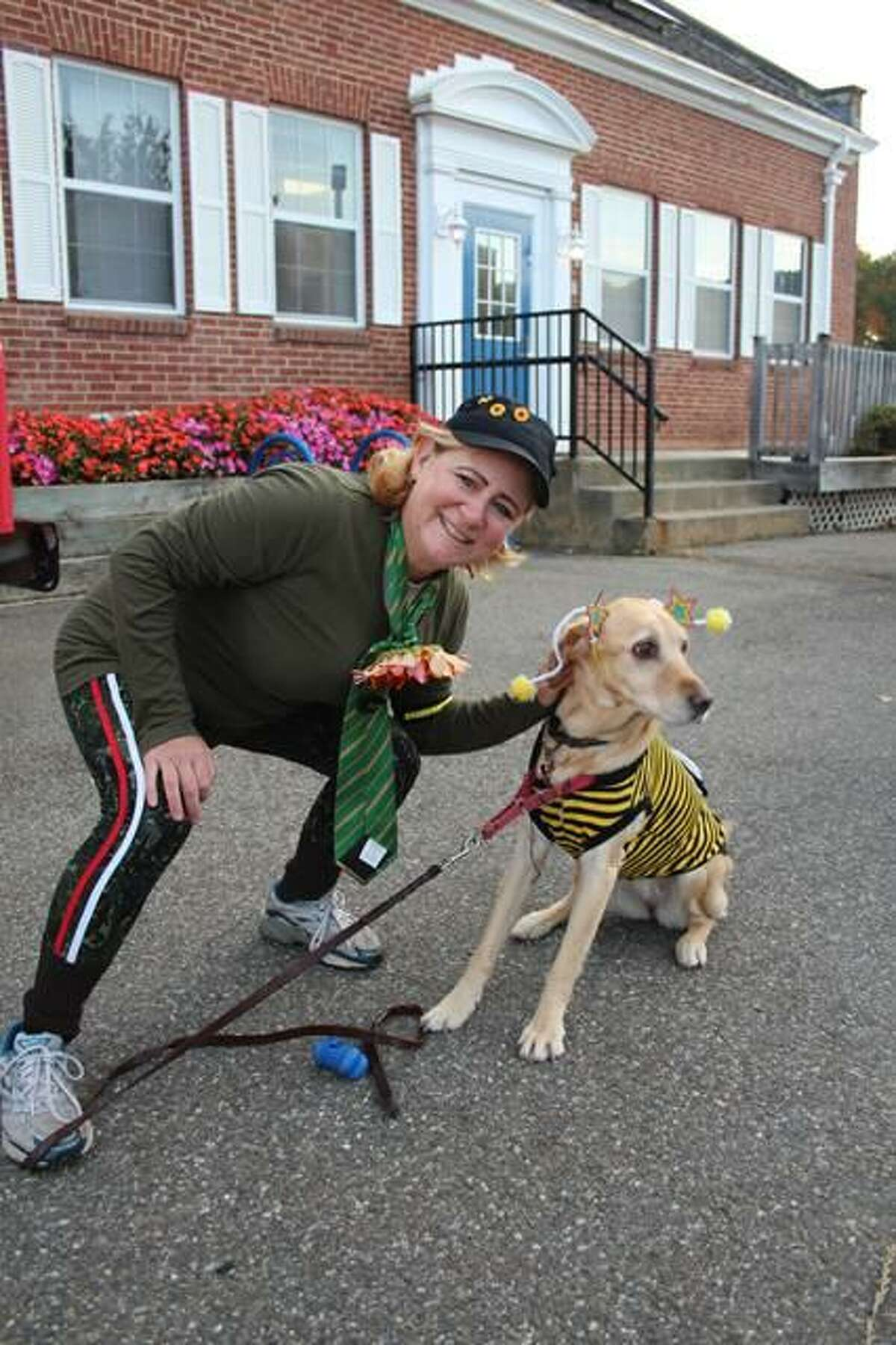 Shaileen Landsberg and her dog Abby the Labby dressed up in costume while they ran in the 2019 Milford Trick or Trot 5K fundraiser for the Beth-El Center.