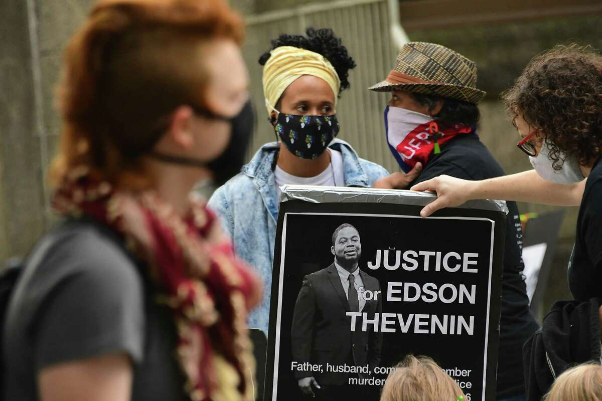 People use 42 minutes to celebrate the life of Edson Thevenin outside Renesslaer County courthouse on Thursday, Sept. 24, 2020 in Troy, N.Y. This year, Edson Thevenin, who was killed by Troy Police Officer Sgt French in 2016, would have been 42 years old. (Lori Van Buren/Times Union)