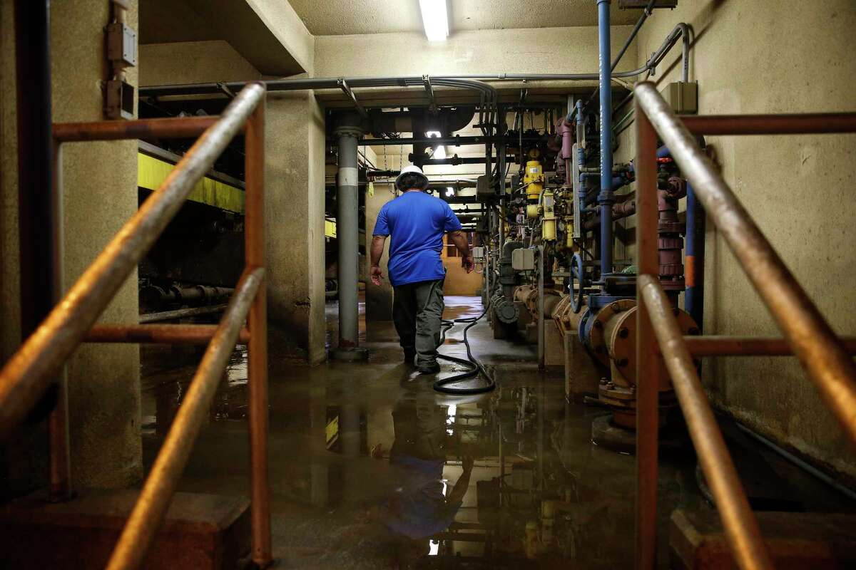 In this file photo from 2018, a worker walks through the 69th Street Wastewater Treatment Plant, the city's largest plant. Scientists are now taking samples of wastewater from each city plant to look for COVID-19 hotspots.
