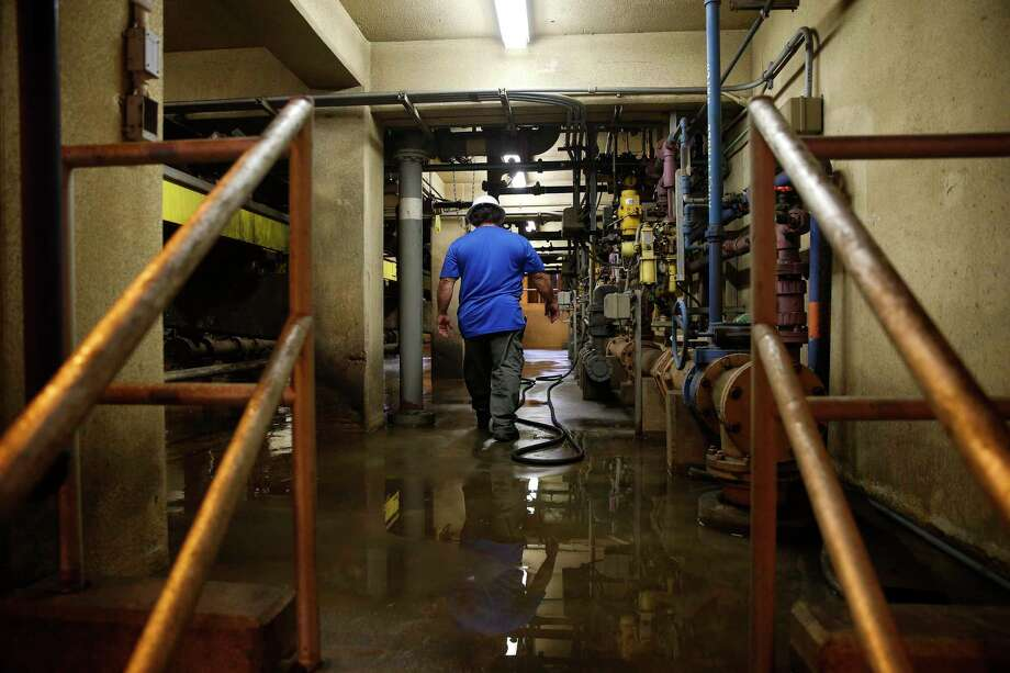 A file photo from 2018 shows a worker at Houston's 69th Street Wastewater Treatment Plant. The city is testing samples from the plants for COVID-19. Photo: Michael Ciaglo, Staff Photographer / Houston Chronicle / © Houston Chronicle