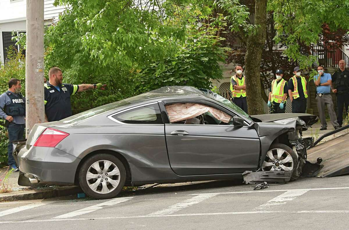 A car is loaded on a flatbed tow truck after being involved in a head on crash on 2nd Street near Dove St. on Thursday, Sept. 24, 2020 in Albany, N.Y. (Lori Van Buren/Times Union)