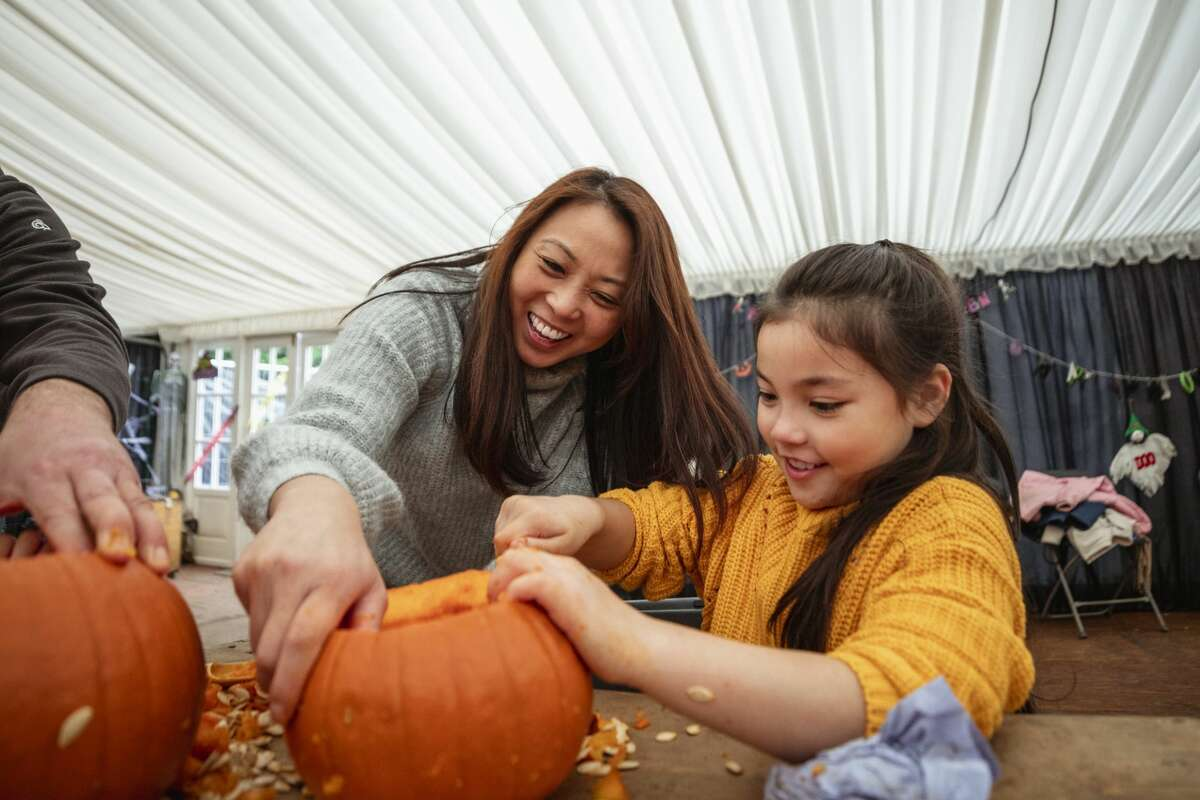 Carving out a spooky jack-o'-latern is one of the more iconic traditions, and luckily, you can still do it safely this year. Decorating or carving pumpkins with members of your household is considered a low risk activity. The CDC also states that decorating pumpkins with neighbors or friends that are not in your household can still be safe if it's done outside and social distance is maintained.