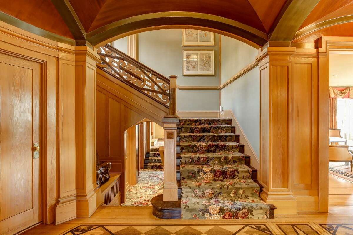 The interior gleams: hard wood floors, paneled walls and arched ceilings catch natural light and bathe the home in a golden hue.