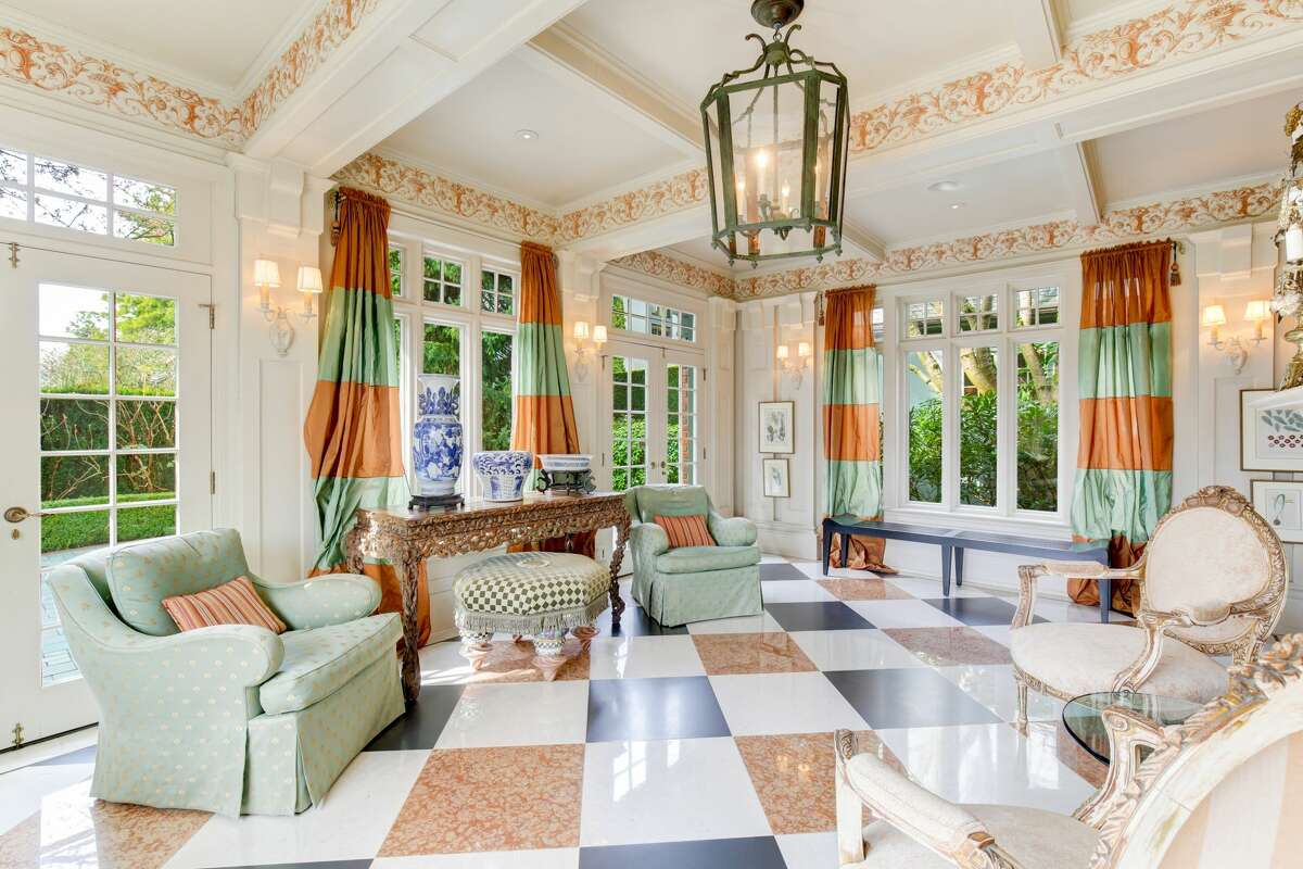 Decorative molding and tiles enhance the historic luxury of the home.