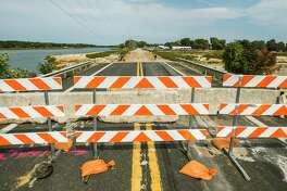 The M-30 bridge over Sanford Lake near Stryker's Marina remains closed Tuesday after it was destroyed during the May 19 mid-Michigan dam failures. (Katy Kildee/kkildee@mdn.net)