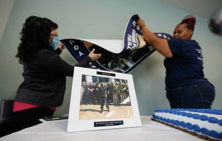 An image of LaCoshia Williams' 16-year-old daughter, Lauryn, is seen beside a cake for the Conroe Police Department, Thursday, Sept. 24, 2020, in Conroe. Lauryn died three years ago of complications from multiple medical problems due to a rare chromosomal defect, but not before being granted her wish of becoming a Conroe police officer for a day. Members of the department honored Lauryn at her funeral with an honor guard escort. Photo: Jason Fochtman, Houston Chronicle / Staff Photographer / 2020 © Houston Chronicle