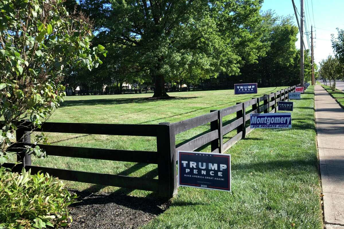 Signs in support of President Donald Trump and other Republican candidates on a lawn of a suburban Dublin, Ohio, home on Sept. 18.