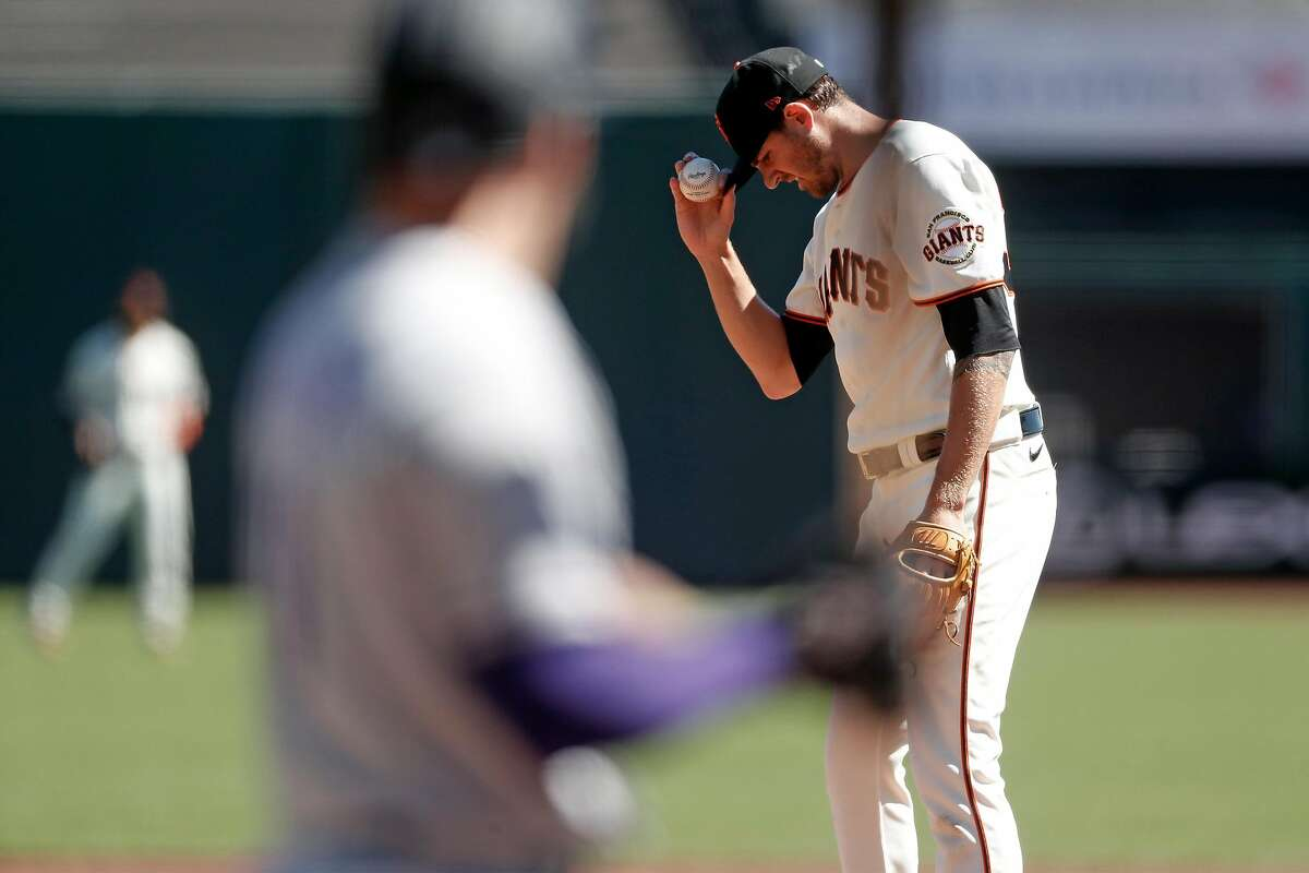 San Francisco Giants' Kevin Gausman prepares to pitch to Colorado Rockies' Kevin Pillar in 1st inning during MLB game at Oracle Park in San Francisco, Calif., on Thursday, September 24, 2020.
