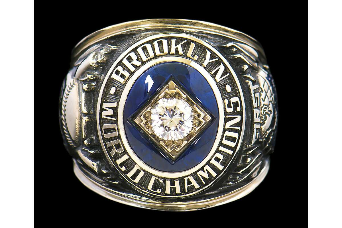 This photo released by Hunt Auctions shows broadcaster Vin Scully's the 1955 Brooklyn Dodgers World Series Championship ring. Scully has culled items from his personal collection of memorabilia for auction on Sept. 23. (Hunt Auctions via AP)