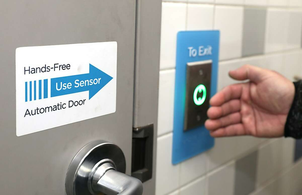 Vice President of design and integration Pete Gualfetti checks as he shows the keyless and touchless bathroom features at the Pacific Heights Chevron participating in a pilot program with the Good2Go app on Tuesday, Aug. 11, 2020, in San Francisco, Calif.