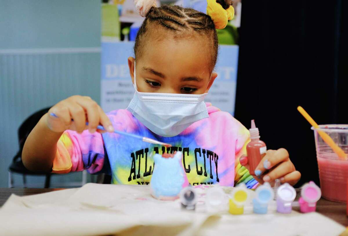 Taylor Joseph, 5, paints a figure of a cat during free time period at the Albany Boys & Girls Club on Thursday, Sept. 24, 2020, in Albany, N.Y. (Paul Buckowski/Times Union)