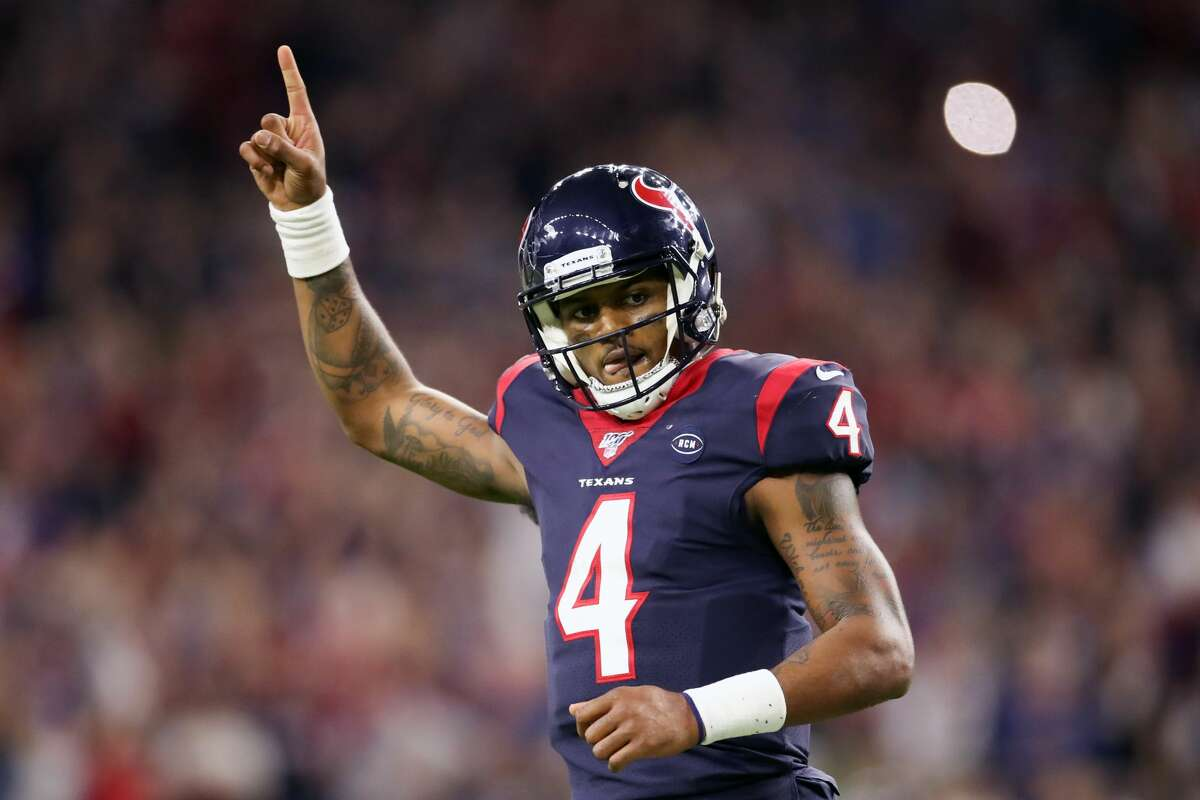 HOUSTON, TEXAS - JANUARY 04: Deshaun Watson #4 of the Houston Texans celebrates a touchdown pass against the Buffalo Bills during the fourth quarter of the AFC Wild Card Playoff game at NRG Stadium on January 04, 2020 in Houston, Texas. (Photo by Christian Petersen/Getty Images)