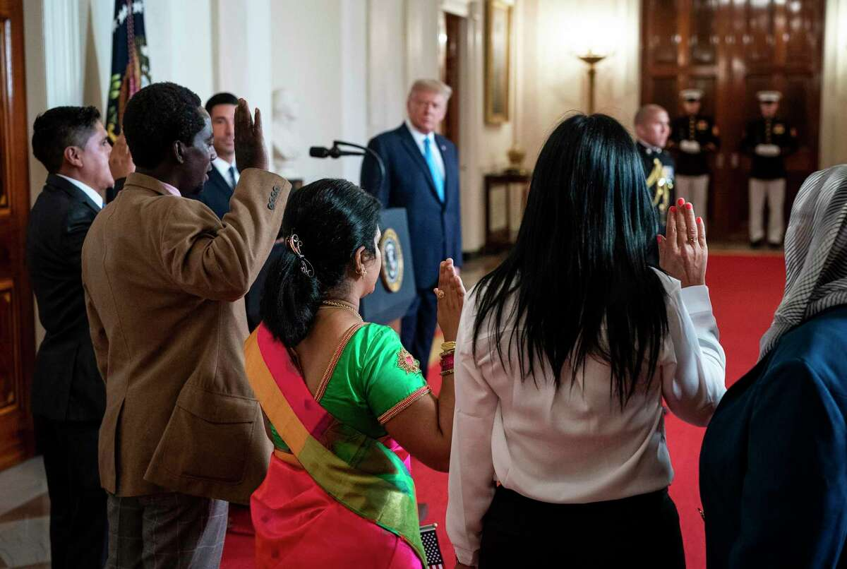 President Donald Trump participates in a naturalization ceremony at the White House in Washington, during the Republican National Convention, on Tuesday, Aug. 25, 2020. Even as the Republican convention tries to soften President Trump's image, he has made it clear that the extreme immigration policies of his first four years will be central to his re-election pitch.