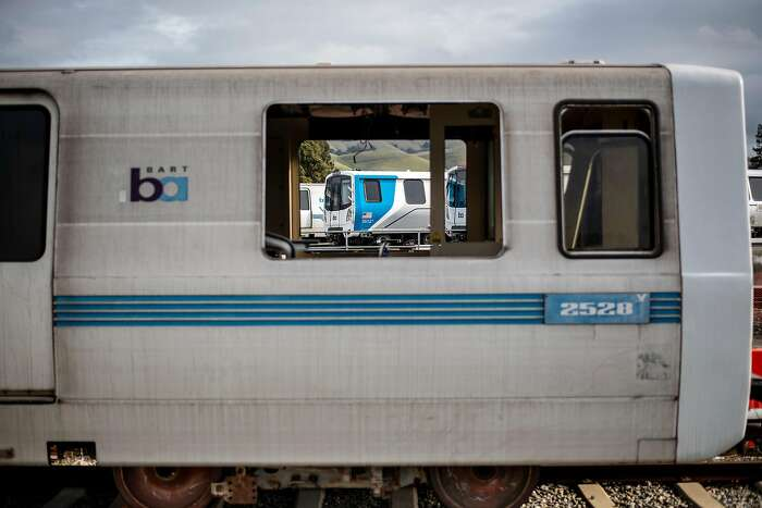BART car 2528, slated to be the first decommissioned as new trains enter the transit system's fleet, rests at BART's Hayward, Calif., maintenance yard on Wednesday, Jan. 9, 2019. In the background is one of the new cars.