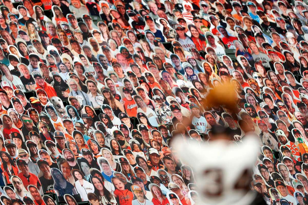 San Francisco Giants' Kevin Gausman pitches in 4th inning in front of a sea of fan cut outs while playing Colorado Rockies in MLB game at Oracle Park in San Francisco, Calif., on Thursday, September 24, 2020.