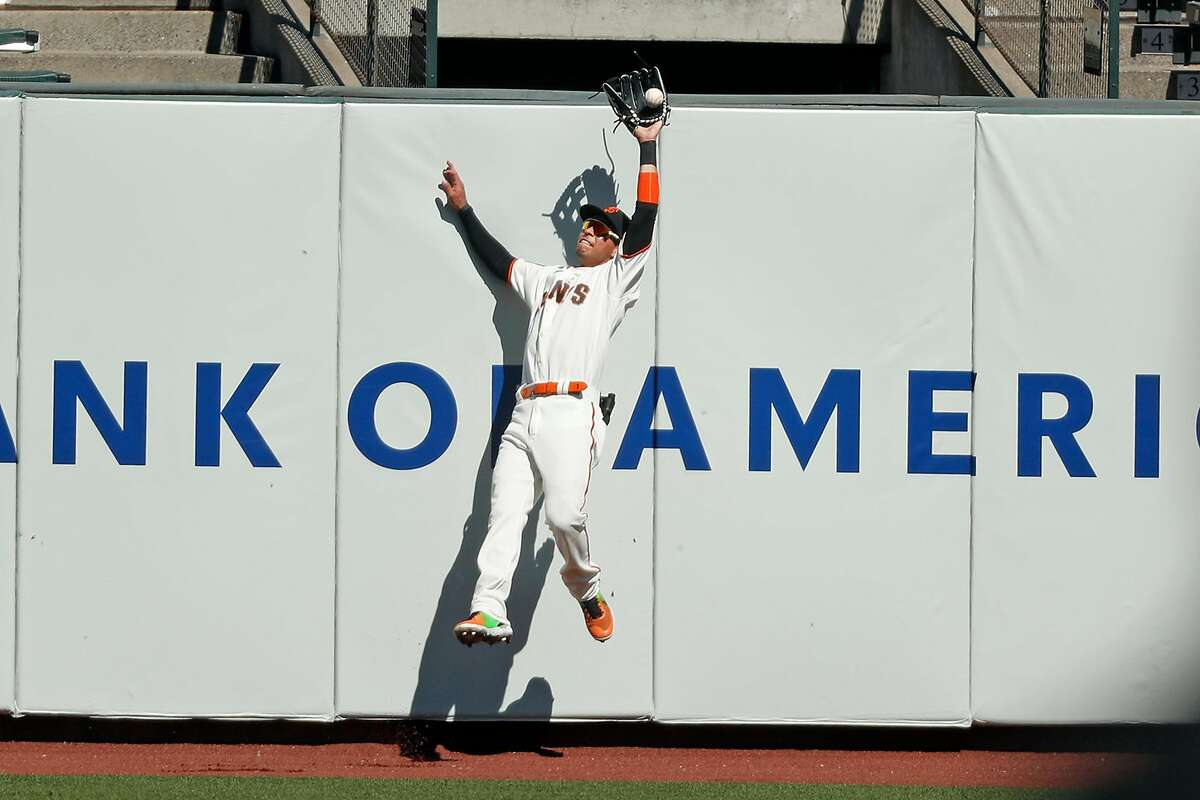 Giants center fielder Mauricio Dubón catches a deep fly off the bat of the Colorado Rockies' Josh Fuentes in the fifth inning during a game at Oracle Park on Sept. 24. Dubón started 31 of the Giants' final 37 games in center.