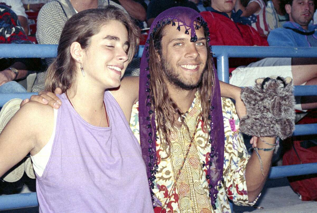Two fans enjoy the atmosphere as The Grateful Dead perform at Shoreline Amphitheatre on Oct. 5, 1989, in Mountain View.