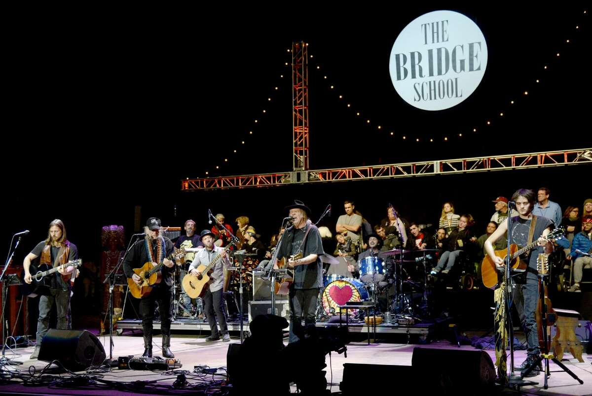 Willie Nelson and Neil Young perform during the 30th Annual Bridge School Benefit at Shoreline Amphitheatre on Oct. 23, 2016, in Mountain View.