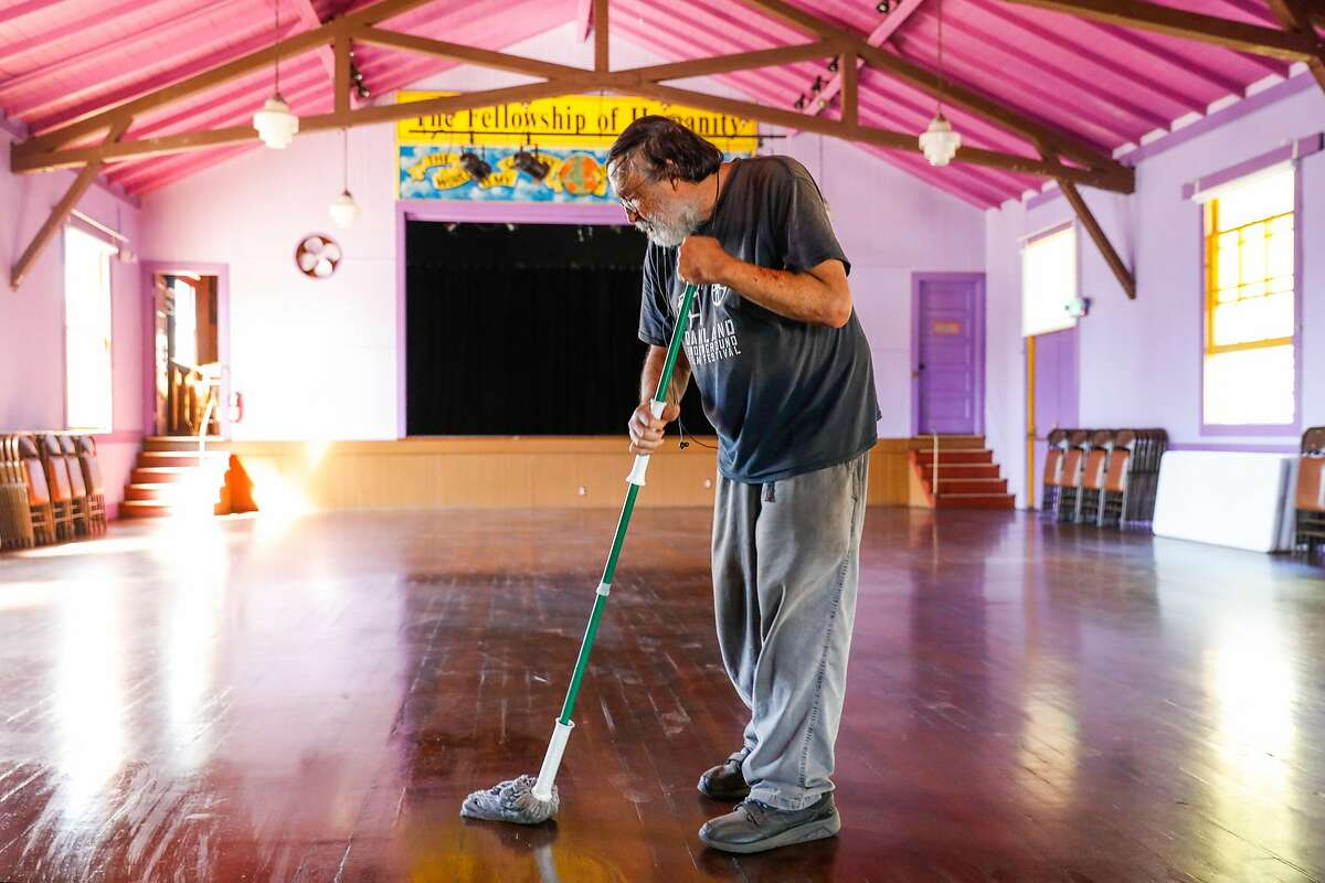Humanist Hall event manager David Oertel mops the floors at the event space on Thursday, Sept. 24, 2020 in Oakland, California.