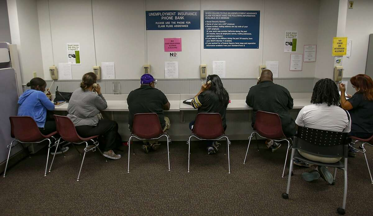 Claimants using a phone bank at the California Employment Development Department in Sacramento.