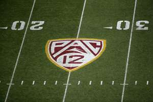 Pac-12 logo on the field during the NCAAF game at Sun Devil Stadium on November 9, 2019 in Tempe, Arizona. The Trojans defeated the Sun Devils 31-26. (Photo by Christian Petersen/Getty Images/TNS)