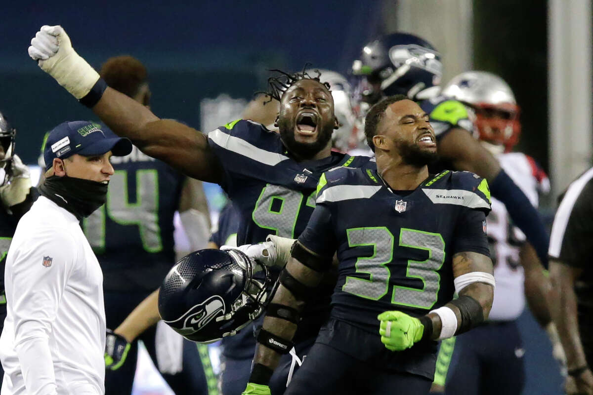 Seattle Seahawks' Jamal Adams (33) and L.J. Collier, left, celebrate after the Seahawks beat the New England Patriots 35-30 in an NFL football game, Sunday, Sept. 20, 2020, in Seattle.