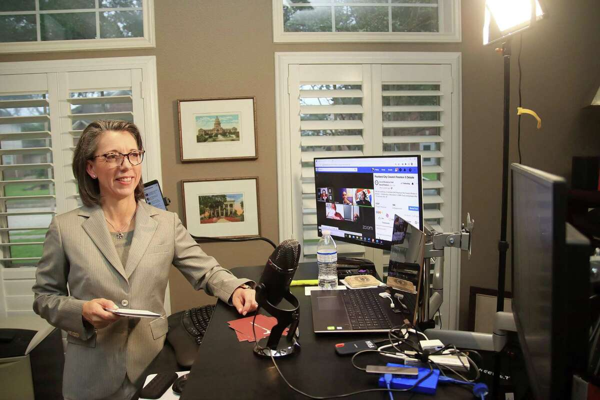 Felicia Harris Hoss sets up at her home office for a Zoom virtual forum she was moderating for candidates in a local election.