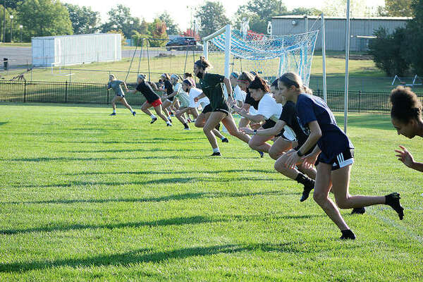 Members of the Lewis and Clark Community College women's soccer team take off during sprints during their 7:15 a.m. practice at Tim Rooney Stadium on the LCCC campus in Godfrey. Thursday was the first day allowed for fall off-season practices. Soccer has been moved from fall to next spring because of the COVID-19 pandemic.