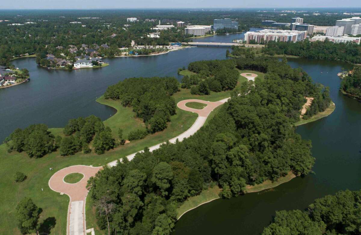 """The ongoing development on Mitchell Island is seen, Friday, Sept. 18, 2020, in The Woodlands. The island, currently empty, was set to have 19 mega mansions built on it. Now, Howard Hughes officials want to build 58 different homes. Now a group of determined residents have formed a group to raise awareness of the American Bald Eagles using the island, the new group is called """"Citizens for Eagle Island."""""""