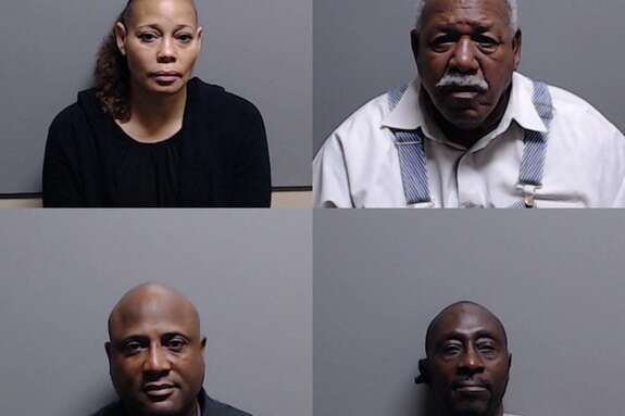 A grand jury returned indictments against the four - Commissioner Shannon Brown is at bottom left, Marlena Jackson, Charlie Burns and DeWayne Ward - for mail-in ballot fraud.