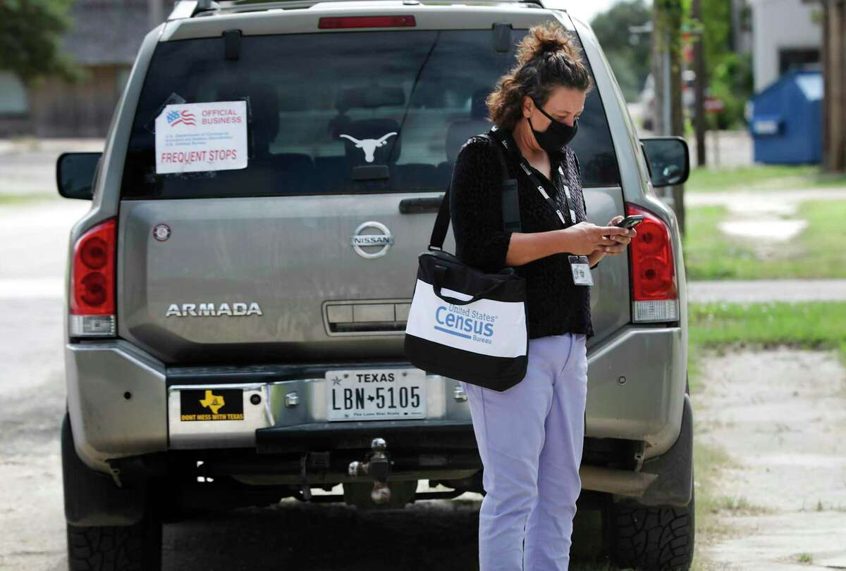 Census worker Tiffany Whitworth visits homes in Rocksprings, in Edwards County. The response rate there is under 18 percent.