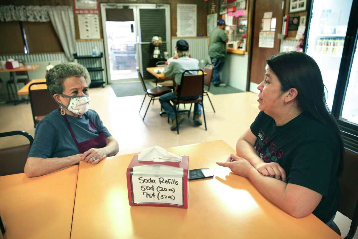 Carillo talks with her mother Dora Maltos, owner of King Burger.