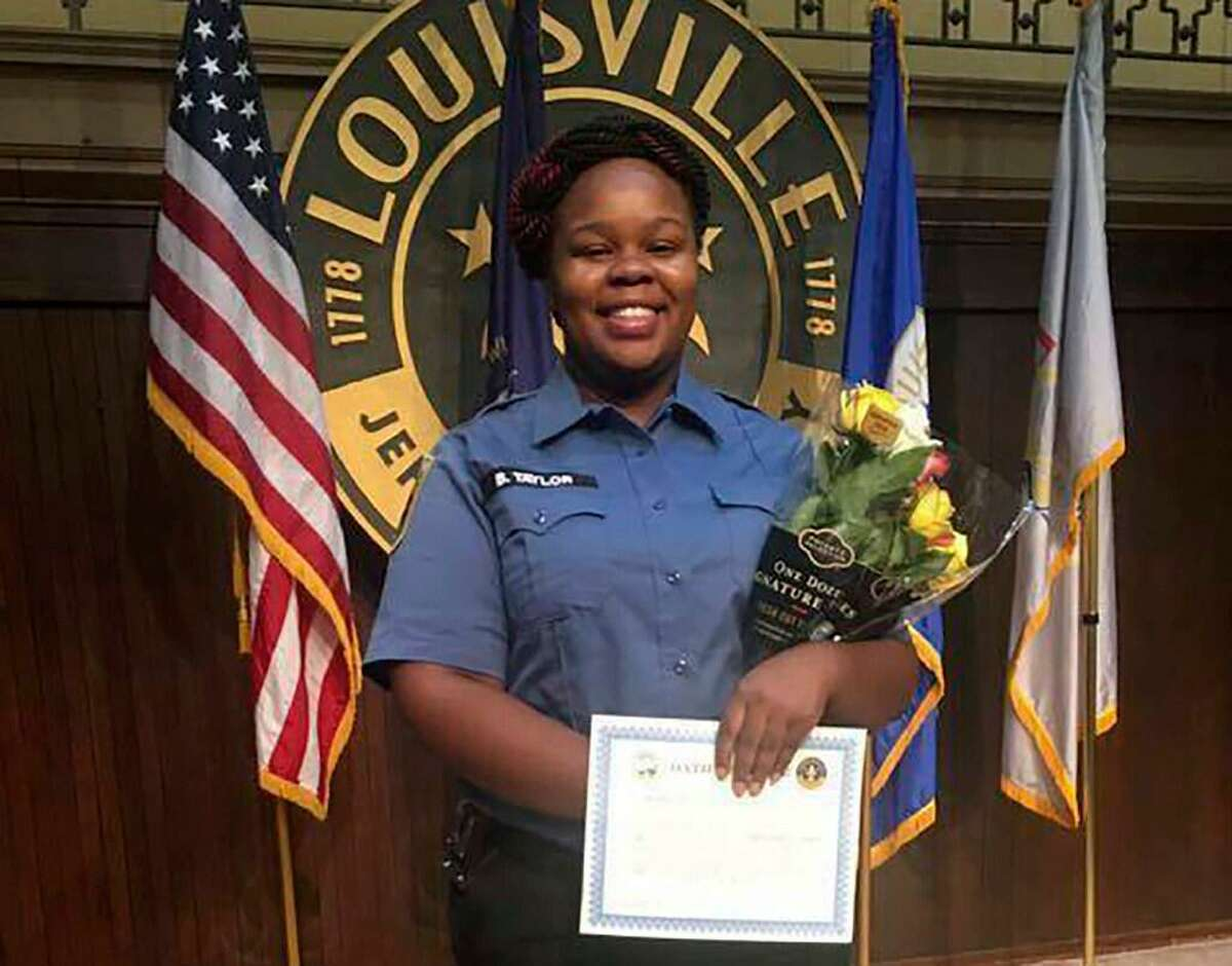 This undated photo provided by Taylor family attorney Sam Aguiar shows Breonna Taylor in Louisville, Ky. Three months after plainclothes detectives serving a warrant busted into Tylor's apartment on March 13, 2020, and shot the 26-year-old Black woman to death, only one of the three officers who opened fire has lost his job.