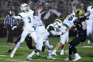 Maloney quarterback Angel Arce passes against Hand in the Class L semifinals in Madison in December.
