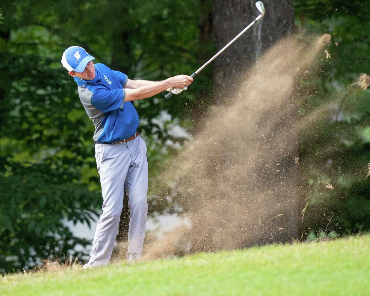 Will Braxton of Saratoga Springs hits an iron shot out of the rough during a Suburban Council match. Braxton is the Athlete of the Year.