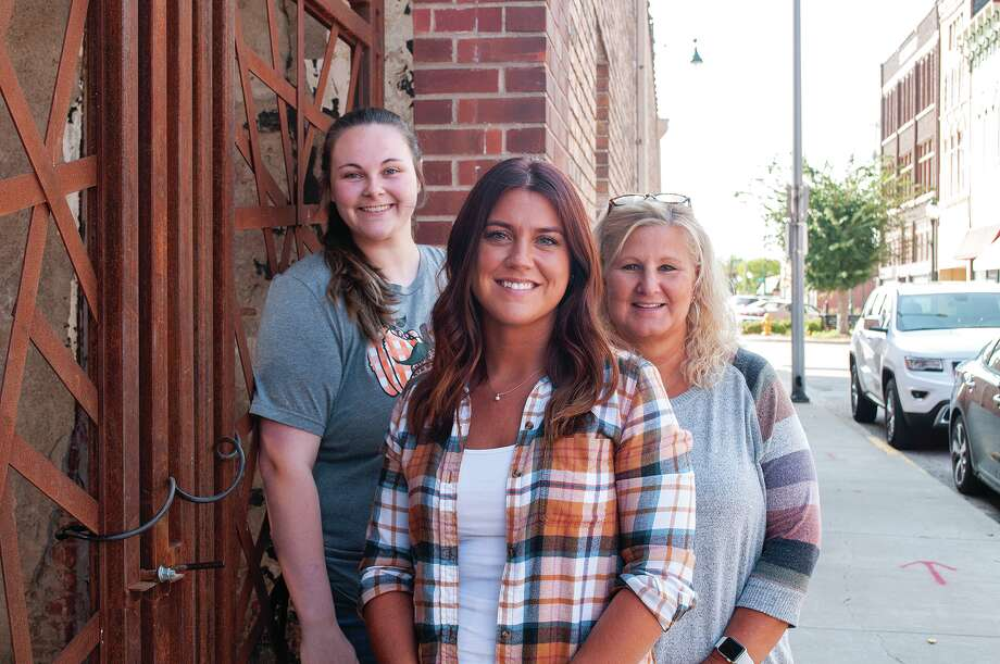 """Community Hope & Recovery Center's Kayla Trenter (front) with Maggie Crowder (left) and Stacey Rock will be turning their porch lights on Wednesday as part of the """"Night to Shine"""" event to raise awareness about suicide. Photo: Darren Iozia 