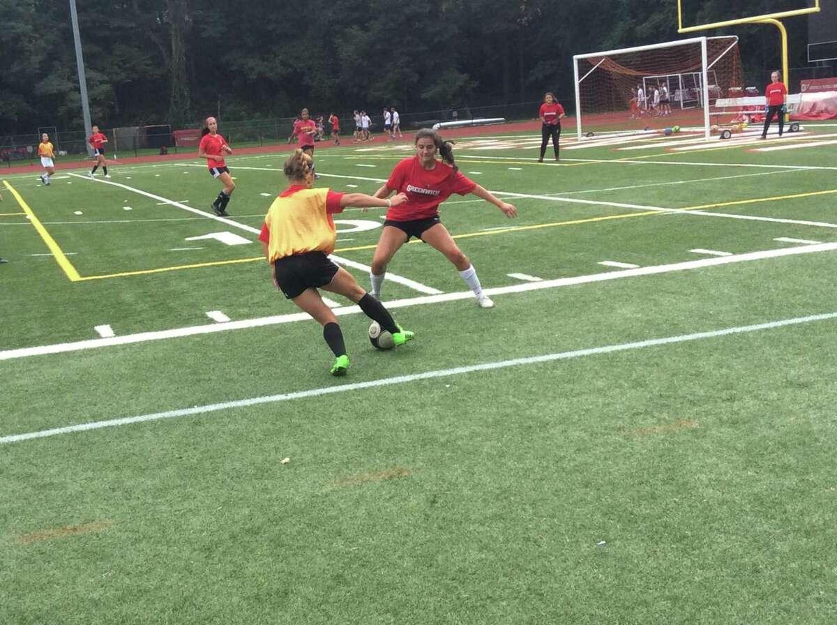 Kristen Berzolla, right, is a senior captain of the Greenwich High School girls soccer team.