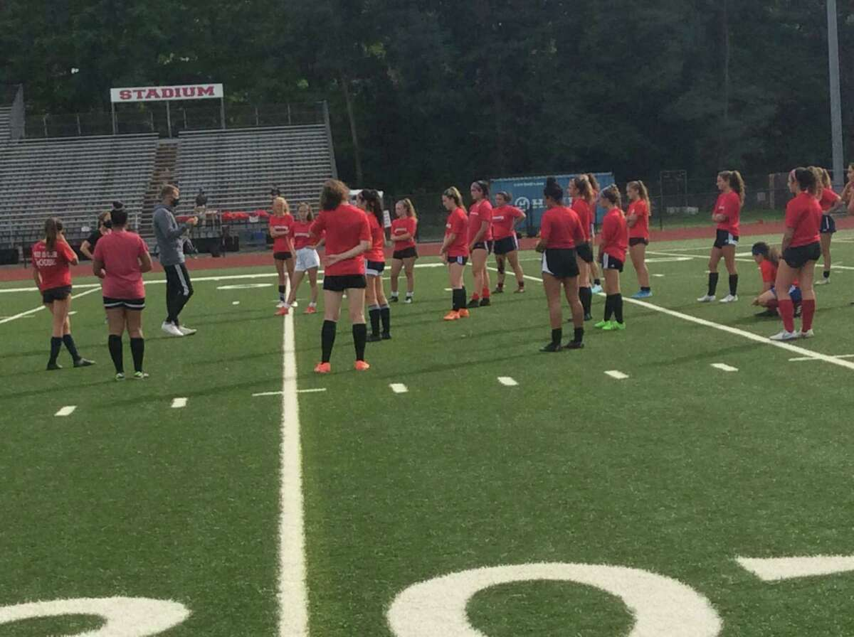 Greenwich High School girls soccer coach Simon Rumbold addresses his team prior to practice on Thursday, Sept, 24, 2020 in Greenwich, Connecticut.
