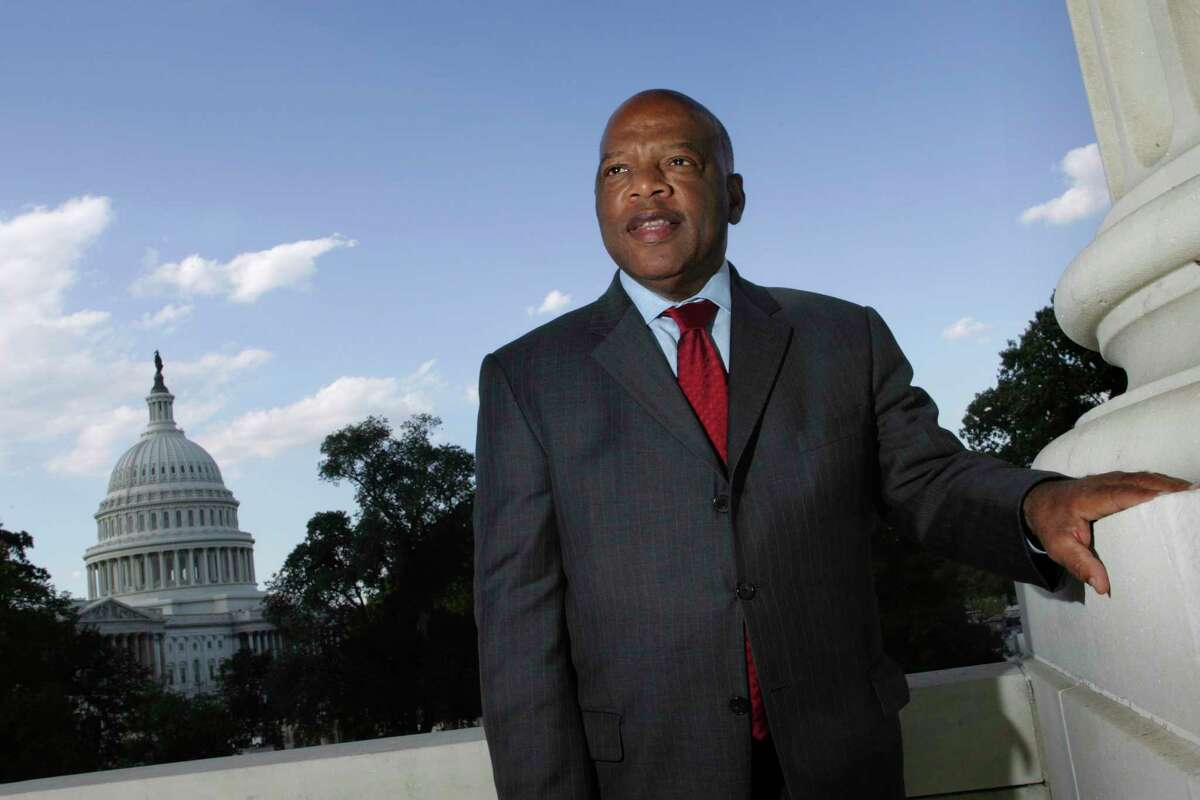 FILE - With the Capitol Dome in the background, U.S. Rep. John Lewis, D-Ga., is seen on Capitol Hill on Oct. 10, 2007, in Washington. The success of CNN's 'RBG' film two years ago, about the late Supreme Court Justice Ruth Bader Ginsburg, led the network on a search for a similar contemporary figure whose life could be examined in historical terms. CNN's Amy Entelis says that led them to Lewis, who died of cancer in July. The film