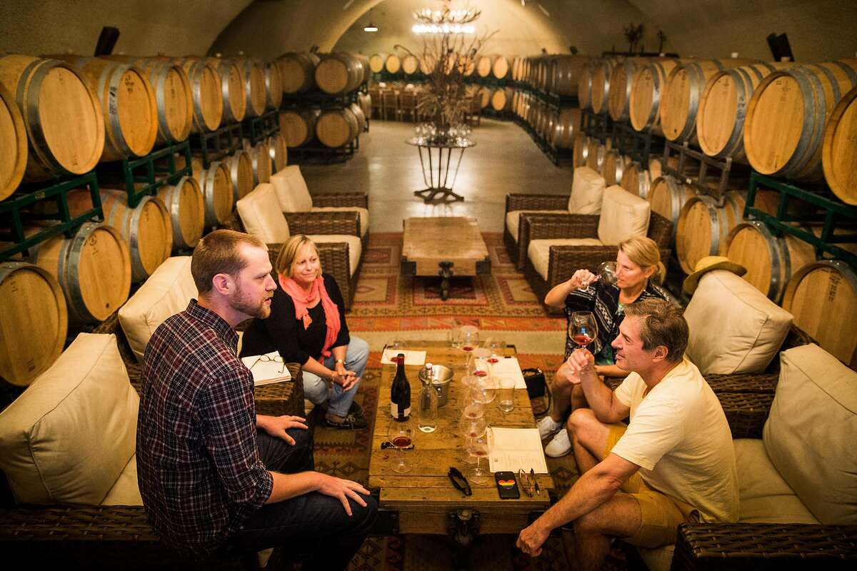 James Allen, left, leads a wine tasting at Failla Wines in St. Helena, California on June 28, 2017.
